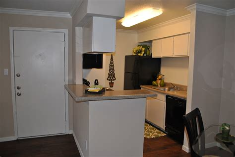 kitchens with wood floors parque view apartments amenities 8786