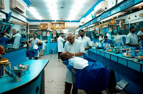 men receive shaves   barbershop   india