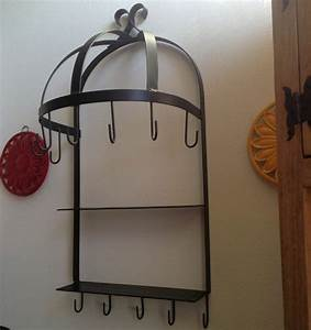 Wall mounted semi circle hanging kitchen pot rack for Kitchen colors with white cabinets with black wrought iron wall mounted candle holder