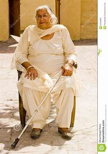 Old Woman Sitting With A Walking Stick Royalty Free Stock