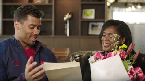 russell wilson surprised  mom  reading touching