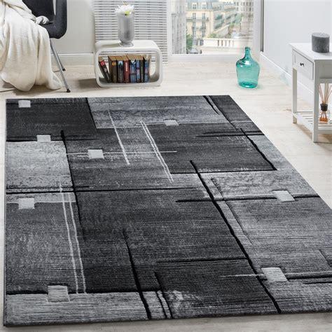 teppich schwarz grau designer teppich konturenschnitt abstrakt karo linien grau schwarz meliert teppiche kurzflor