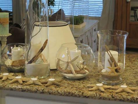glass cylinders vases bowls filled  rocks sand