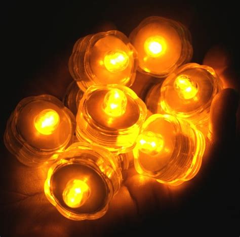 amber led tea lights pack of 96 amber yellow submersible waterproof