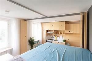 Cloison Sur Rail : cloison mobile et rangements malins en bois dans un studio de 34 m ~ Nature-et-papiers.com Idées de Décoration