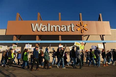 demonstrators march in lakewood in support of walmart