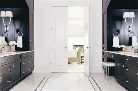 black master bathroom with white bi fold doors transitional bathroom