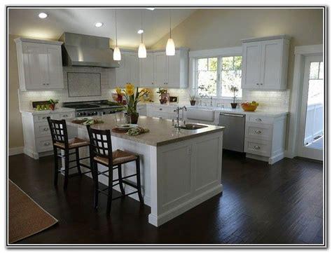 white shaker kitchen cabinets dark wood floors kitchen