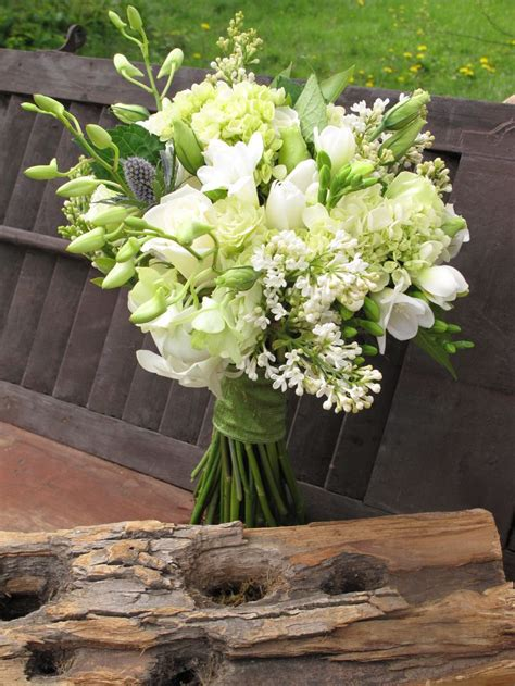 Spring Bridal Bouquet Of White Lilacs Freesia Roses