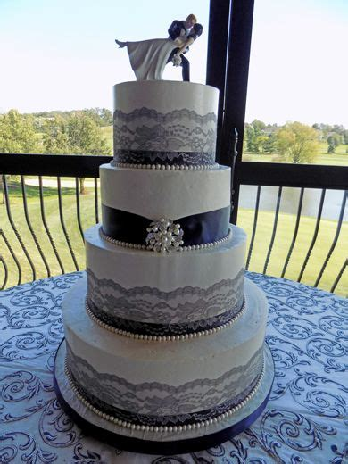 tier buttercream wedding cake decorated  navy blue