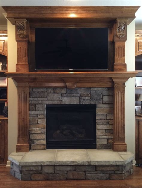 Fireplace With Tv Above by Stacked Replaces Tile Surround And Hearth And Tv