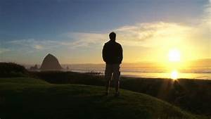 Man at Pacific Ocean near Cannon Beach looks out to sea as ...