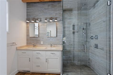 gray porcelain tile bathroom starting over seeking simplicity two empty nesters build anew in woolen millsc ville weekly