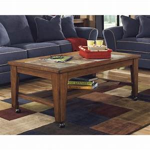Ashley toscana coffee table in rustic brown t353 0 for Rustic dark brown coffee table