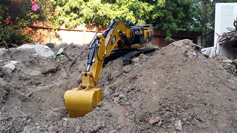 Harga Rc Excavator Cat cat 390d hydraulic rc excavator pile of dirt