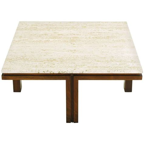 From classic wood to contemporary acrylic, find materials and silhouettes that suit your space. Walnut and Travertine Square Coffee Table with Offset Legs For Sale at 1stdibs