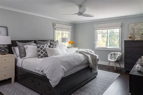 Gray And Black Bedroom by Black Wood Bed With Blond Dresser As Nightstand And Smoke