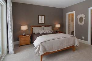 Dark gray paint bedroom traditional with wood nightstands