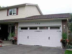 How much do carriage garage doors cost all about house for Carriage style garage doors cost