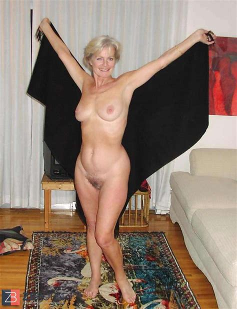 Justine A Mature Platinum Blonde Posing On A Couch Zb Porn