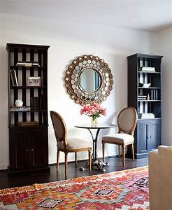 Small Living Room Features Bookcase With Black And White ...