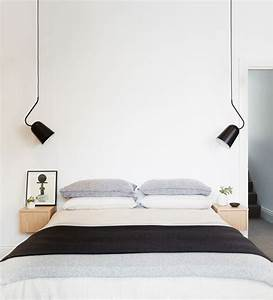 Bedroom with white walls and black pendant lamps home