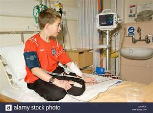 Blood Pressure And Pulse Monitoring On Young Boy In