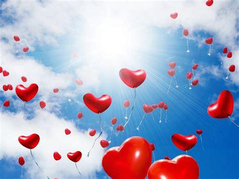 red balloons   shape   heart sunlight blue sky