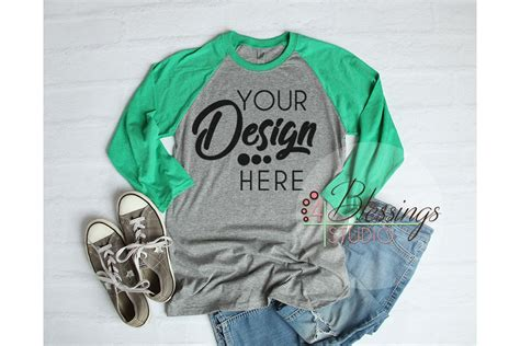 Here we come up with premium and free collections like mockups, backgrounds, fonts, wordpress themes, branding, inspiration, tutorials and informative articles for professional designers and beginners. Raglan Shirt Mockup - Baseball TShirt Gray and Green Raglan