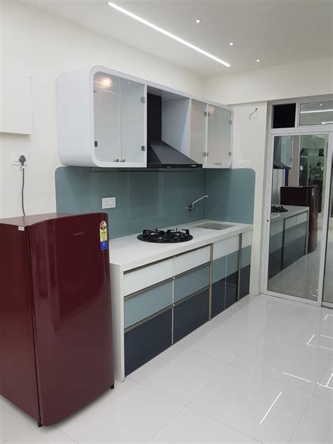 Small Kitchen Design In Yellow Blue Shades by Modular Kitchen With White Counter Top And Blue