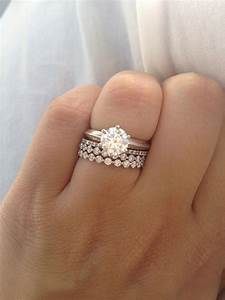 engagement ring on finger With ring for wedding finger
