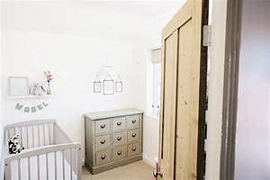 A modern stylish baby nursery decorated on a budget in