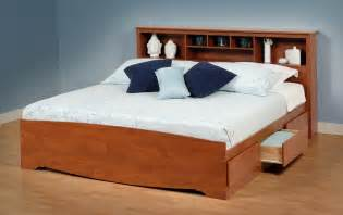 king size light brown lacquered oak wood bed frame with display shelves headboard of the