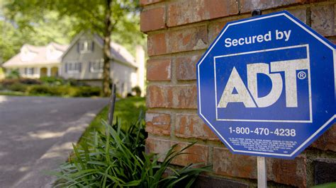 ADT agrees to be bought by Apollo Global Management in a ...