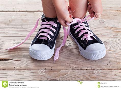 child hands tie  shoe laces stock photo image