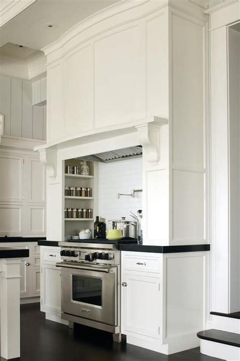 Incredible kitchen with board and batten trimmed stove