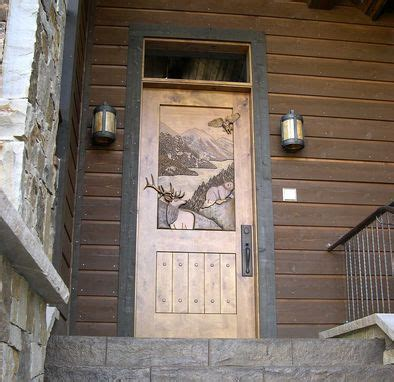 custom hand carved entry door  christies wood  glass