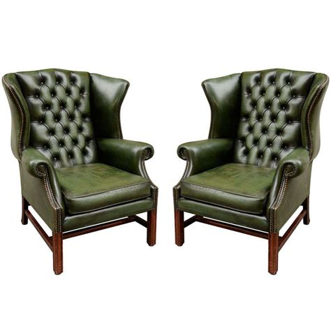 pair of green leather wingback chairs at 1stdibs