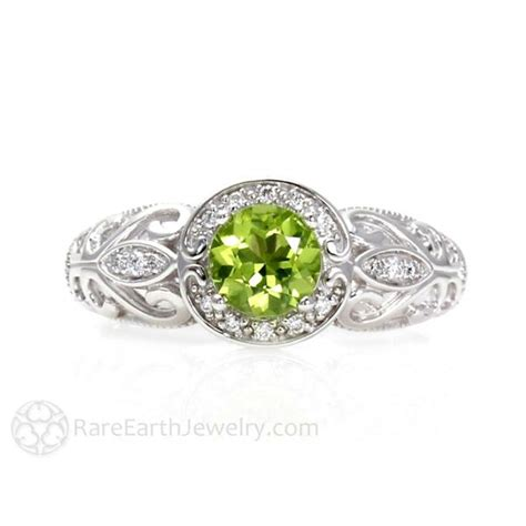 Art Nouveau Peridot Engagement Ring With Diamond Halo. Infinite Engagement Rings. Mansion Wedding Rings. Sculpted Wedding Rings. Enagement Engagement Rings. Tungsten Engagement Rings. South Sea Pearl Rings. Gunmetal Rings. 100 000 Dollar Engagement Rings