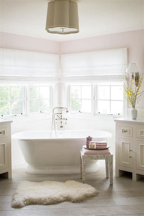 pink master bathroom  corner tub transitional bathroom