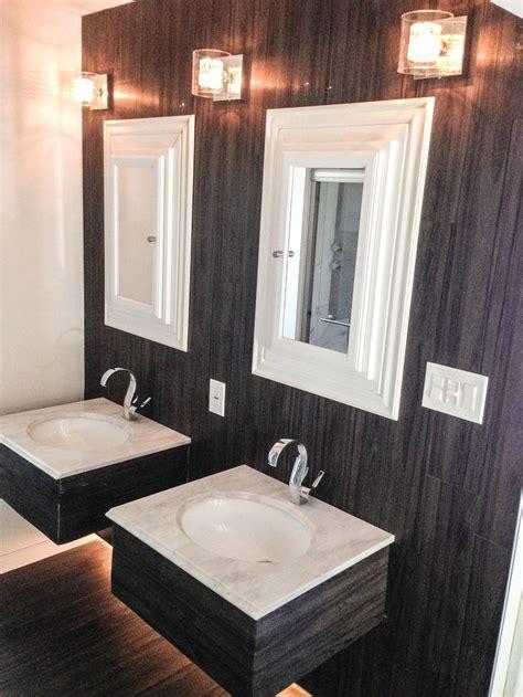 vinyl plank floor installed  wall bathroom double vanity