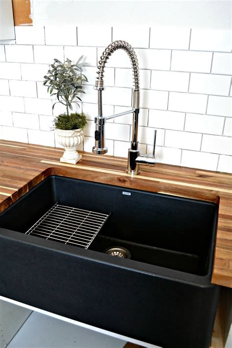 a black farmhouse sink gives our country kitchen a warm feel
