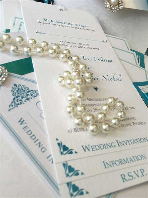 Teal pocket wedding invitation with chequebook insert