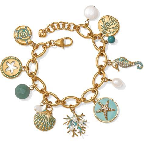 Aqua Shores Aqua Shores Charm Bracelet Bracelets. Angel Wing Pendant. 52mm Watches. Cheap Engagement Rings. Vintage Pearl Bracelet. Black Bands. Celtic Cross Pendant. Golden Anchor Bracelet. Red Leather Watches