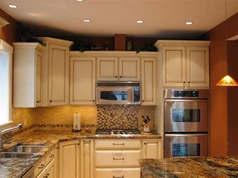 Stove Top Backsplash : Glazed Cabinets. Microwave Over Stovetop. Tile Backsplash