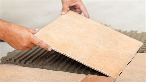 How to Lay Floor Tiles in Kitchens and Bathrooms on to