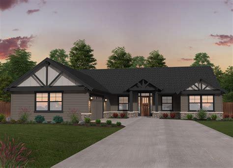 double  ranch single story lodge house plan  mark stewart