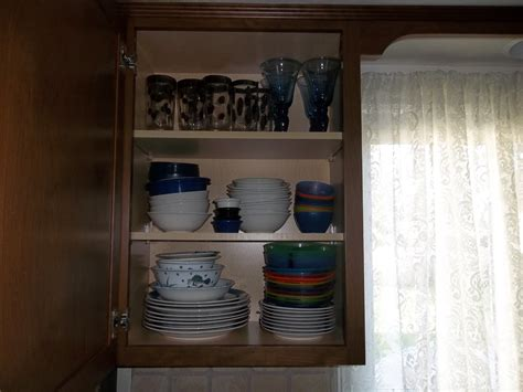 how should i organize my kitchen cabinets organize kitchen cabinets how we got rid of 99 dishes 9278