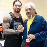 Roman Reigns And The Usos Football | 589 x 591 jpeg 42kB