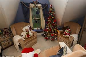 welsh couple put  christmas tree    rooms